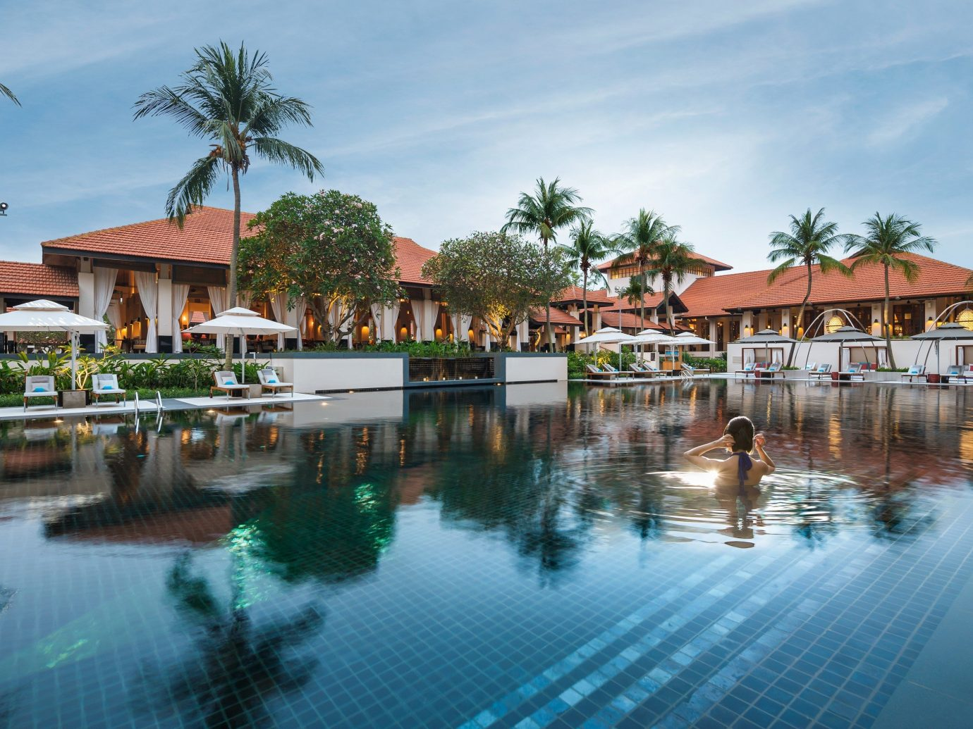 Hotels outdoor water tree sky house swimming pool leisure Resort property estate vacation resort town condominium marina surrounded Town lined several swimming Island