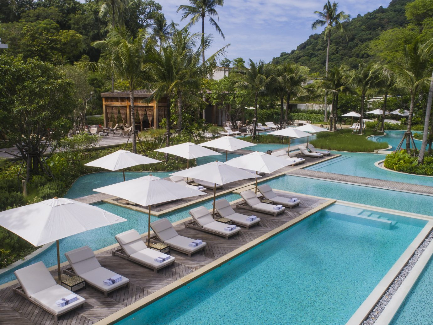Trip Ideas Winter tree outdoor Resort property leisure swimming pool resort town real estate estate condominium palm tree vacation leisure centre arecales Villa lined