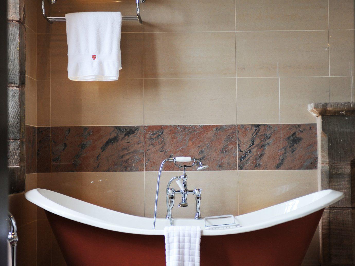Hotels indoor wall bathroom floor room bathtub plumbing fixture flooring interior design tile tub Design sink toilet Bath tiled