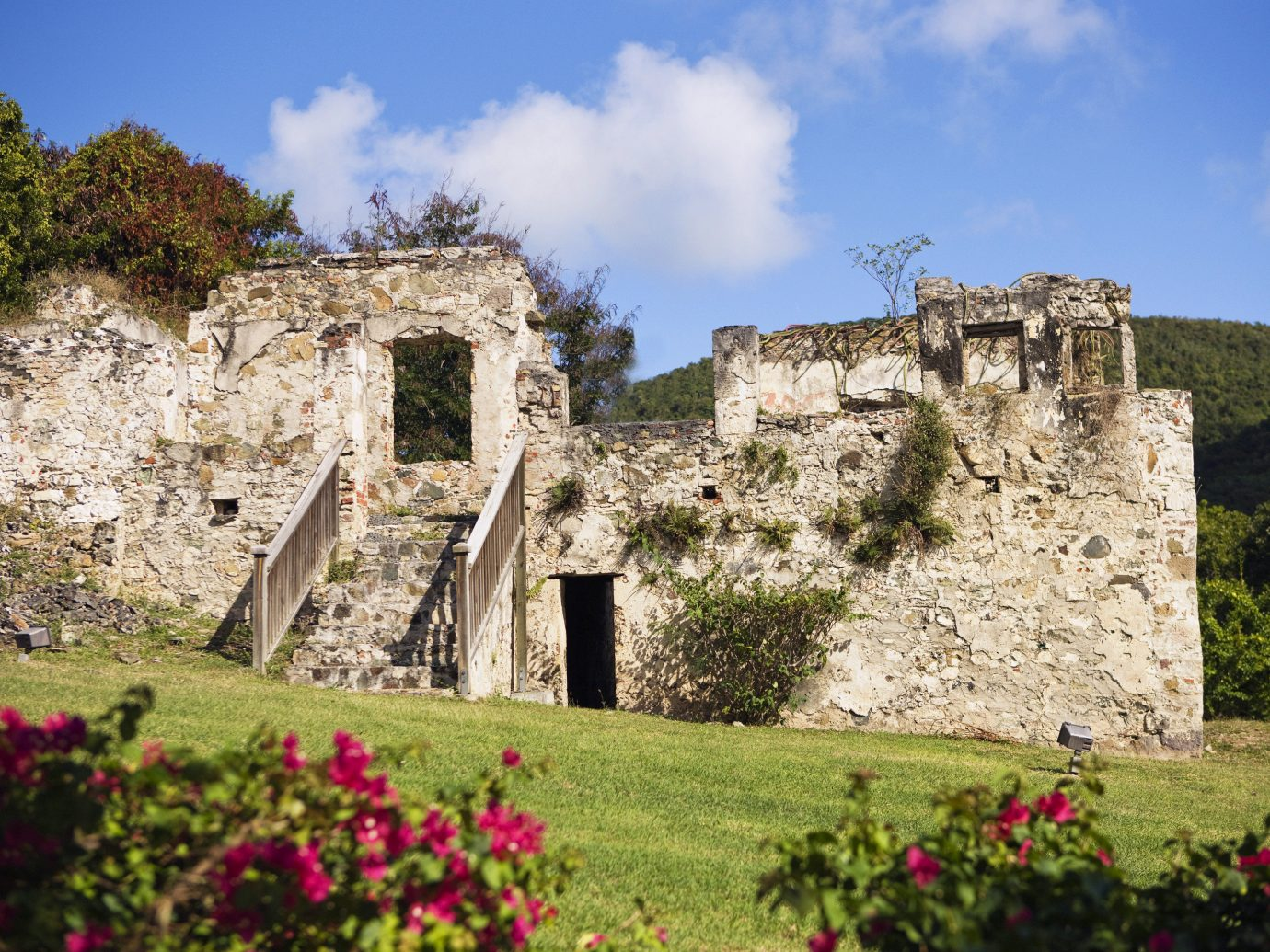 Eco Family Hotels Landmarks Luxury Resort Romance Romantic Tropical grass sky outdoor flower building Ruins stone field rock historic site archaeological site castle fortification tourism ancient history brick Village rural area monastery château abbey old ruin structure Garden