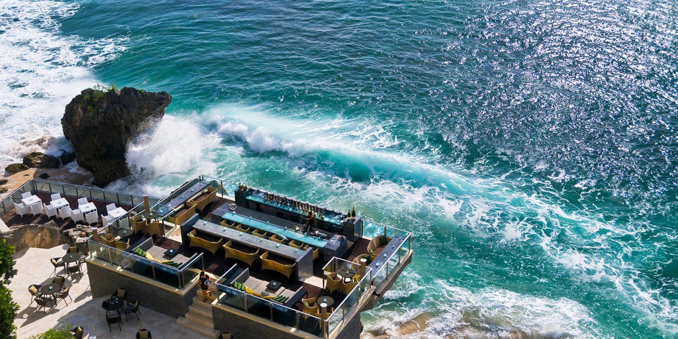 Beach Beachfront Boat Elegant Food + Drink Hotels Lounge Luxury Ocean Trip Ideas water outdoor Sea Coast shore wind wave wave vacation cape vehicle terrain caribbean