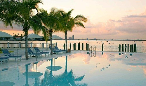 Hotels outdoor sky tree palm Beach Resort vacation swimming pool Ocean caribbean plant Sea arecales Sunset Lagoon bay shore sandy lined several
