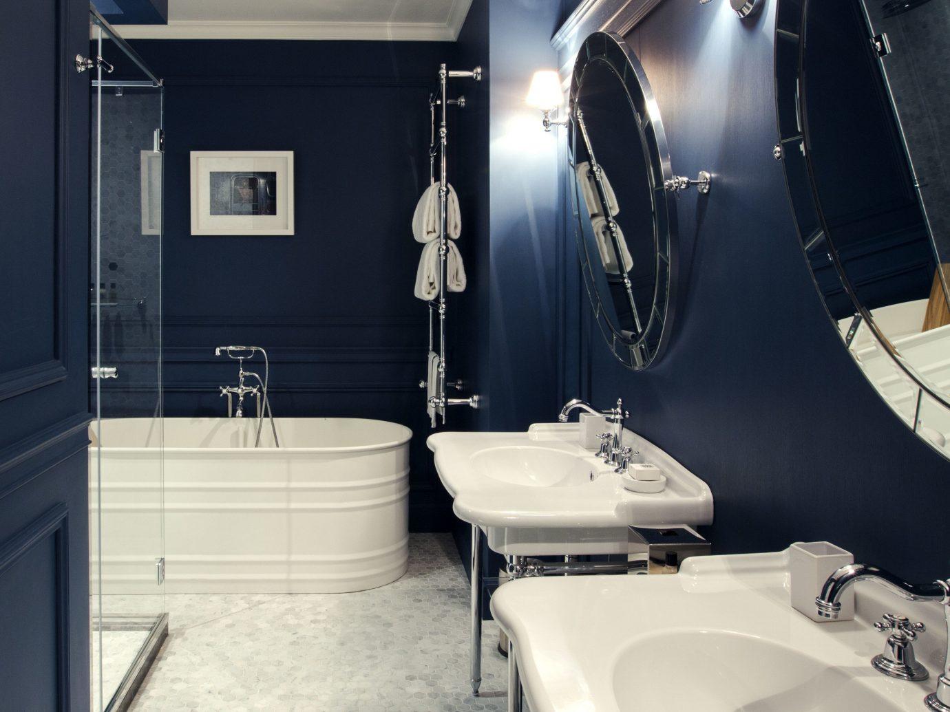 Boutique Hotels Hotels indoor bathroom wall room toilet sink plumbing fixture public toilet interior design bathtub tile tiled