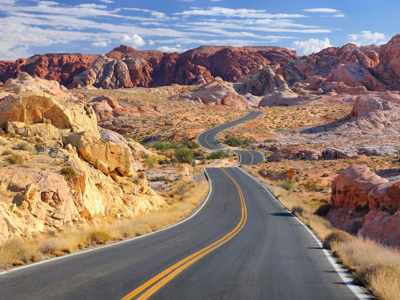 Trip Ideas valley mountain outdoor rock canyon road landform geographical feature natural environment rocky wadi landscape badlands Desert infrastructure highway mountain pass plateau geology nonbuilding structure road trip hillside