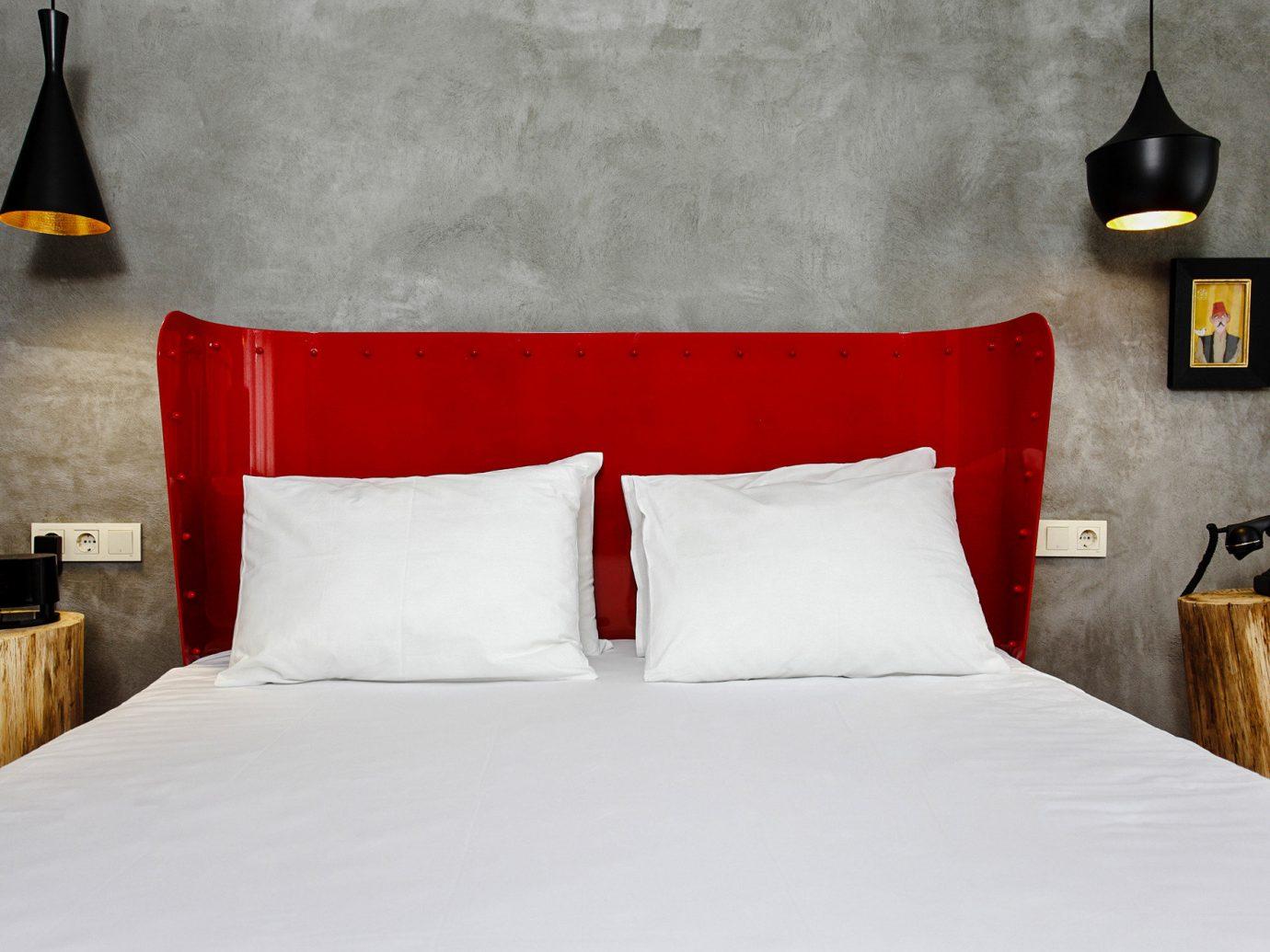 Boutique Hotels Hotels Luxury Travel bed indoor wall red hotel room bed frame bed sheet Suite interior design Bedroom pillow home textile floor furniture duvet cover comfort mattress bedding