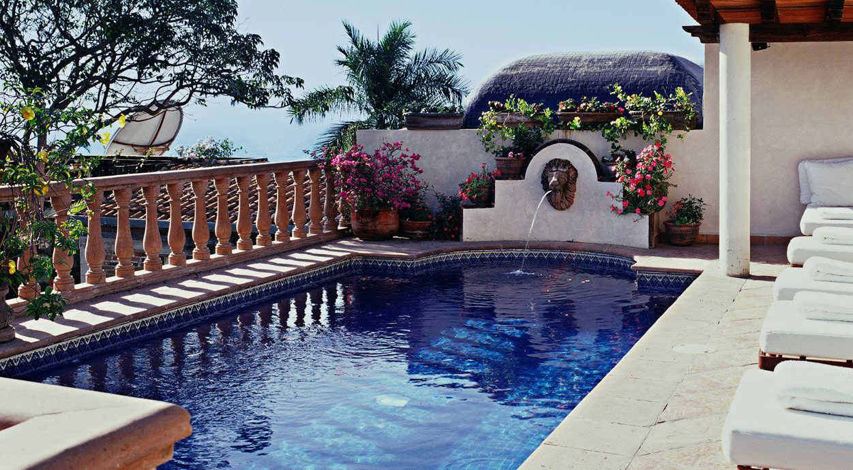 Elegant Hotels Pool Romance Romantic Waterfront tree sky swimming pool property leisure backyard Villa home Resort hacienda mansion