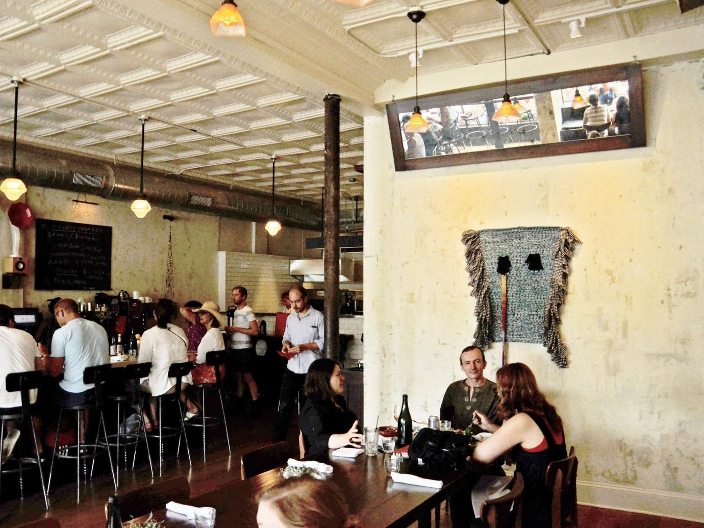 Food + Drink indoor wall person ceiling restaurant group meal several dining room