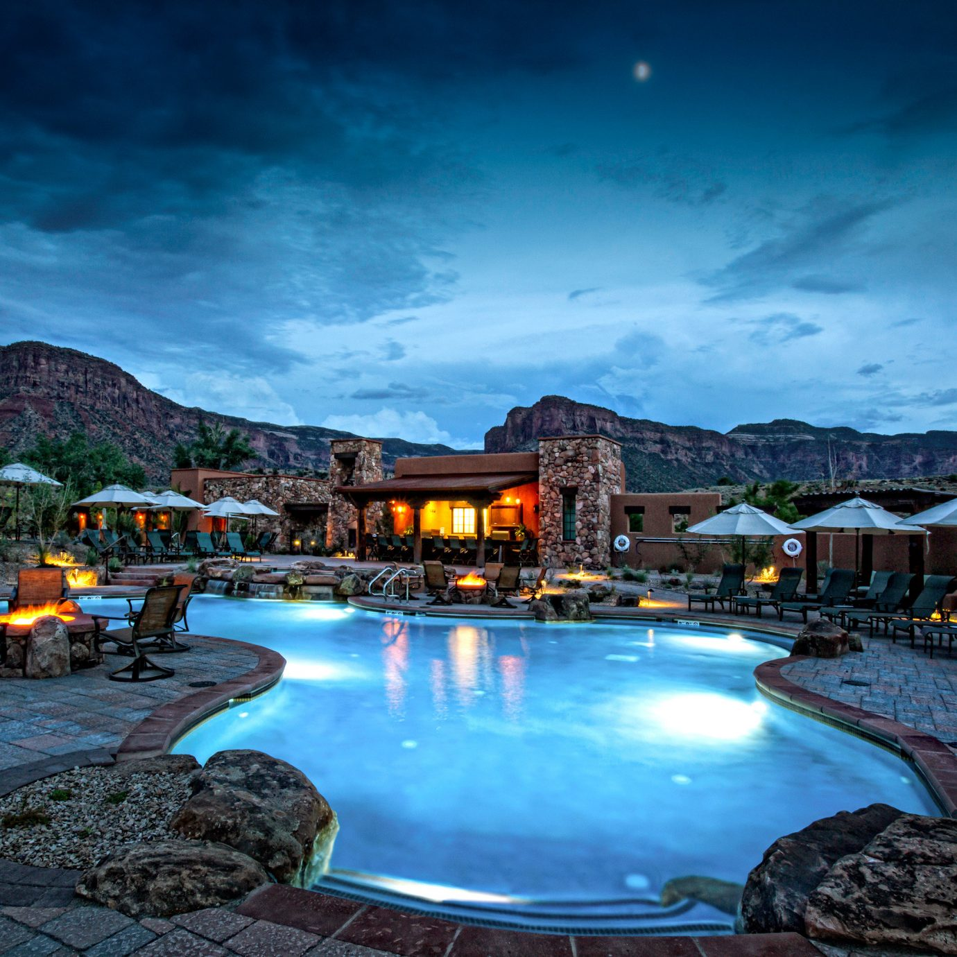 Exterior Fireplace Grounds Mountains Outdoors Pool Rustic Scenic views sky water swimming pool night Resort Harbor evening dusk screenshot