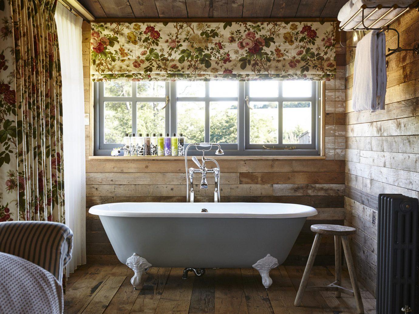 Trip Ideas window floor indoor chair room property tub estate house bathroom home interior design cottage farmhouse real estate bathtub furniture Bath