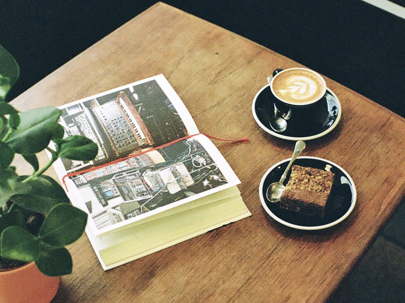 Food + Drink Offbeat Travel Trends table indoor flooring floor wood font hardwood
