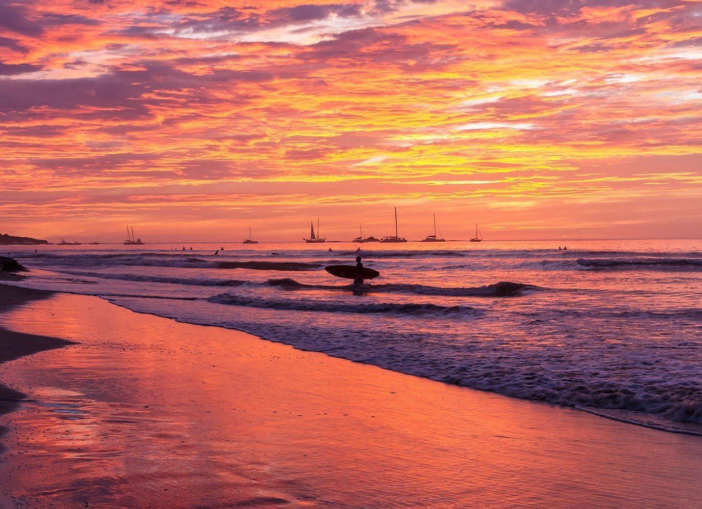 Trip Ideas water outdoor Sunset sky shore Sea sunrise Sun Beach afterglow horizon body of water Ocean dawn Coast cloud pier scene dusk wave evening morning reflection wind wave Nature setting sand
