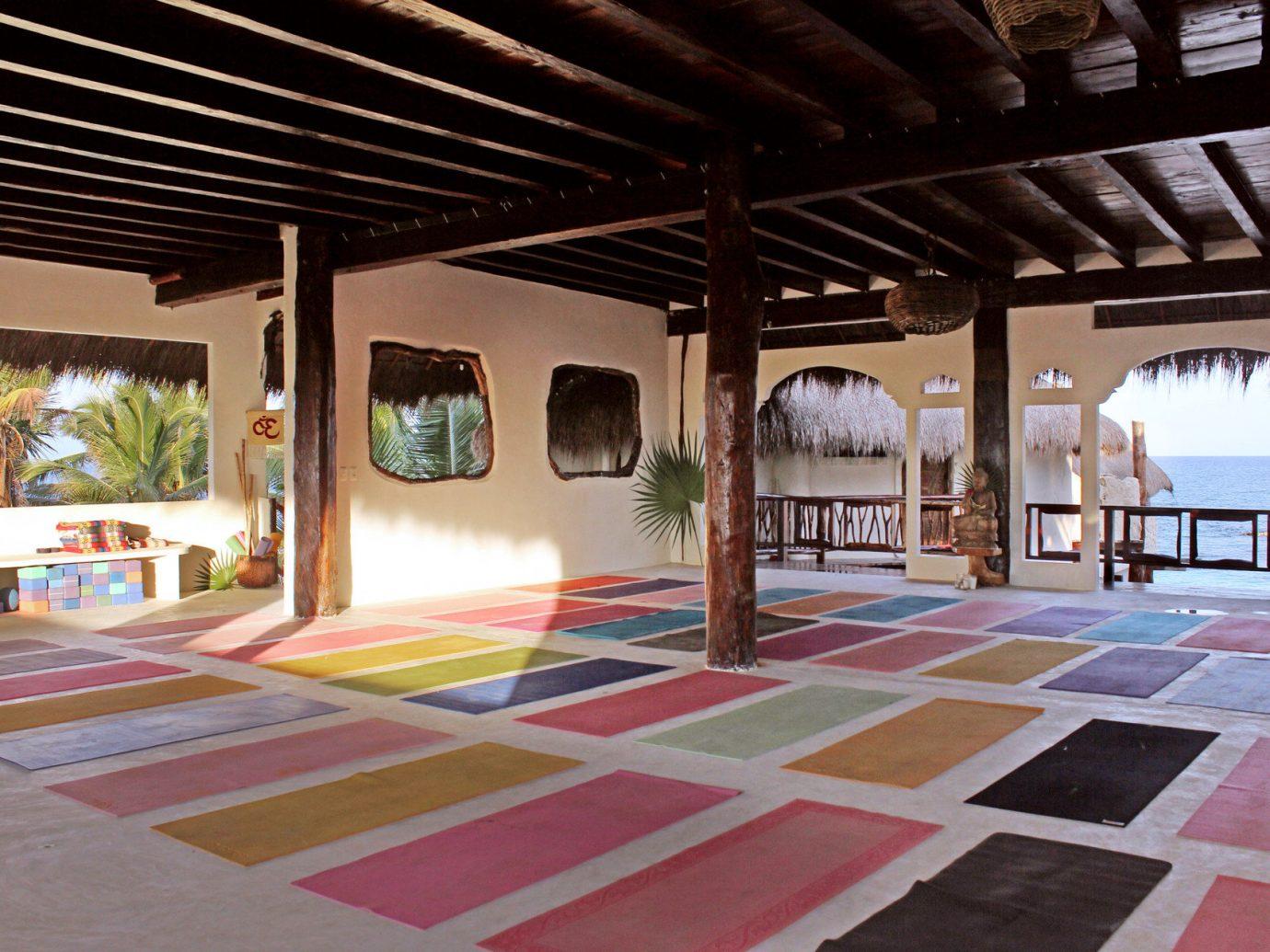 Health + Wellness Hotels Yoga Retreats leisure building property room Resort estate Architecture home interior design Design hacienda floor