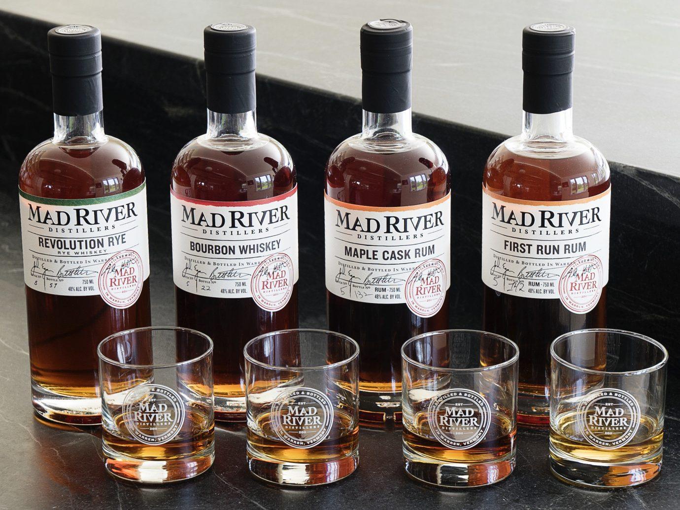 Jetsetter Guides bottle distilled beverage liqueur alcoholic beverage Drink whisky alcohol glass bottle wine bottle beer