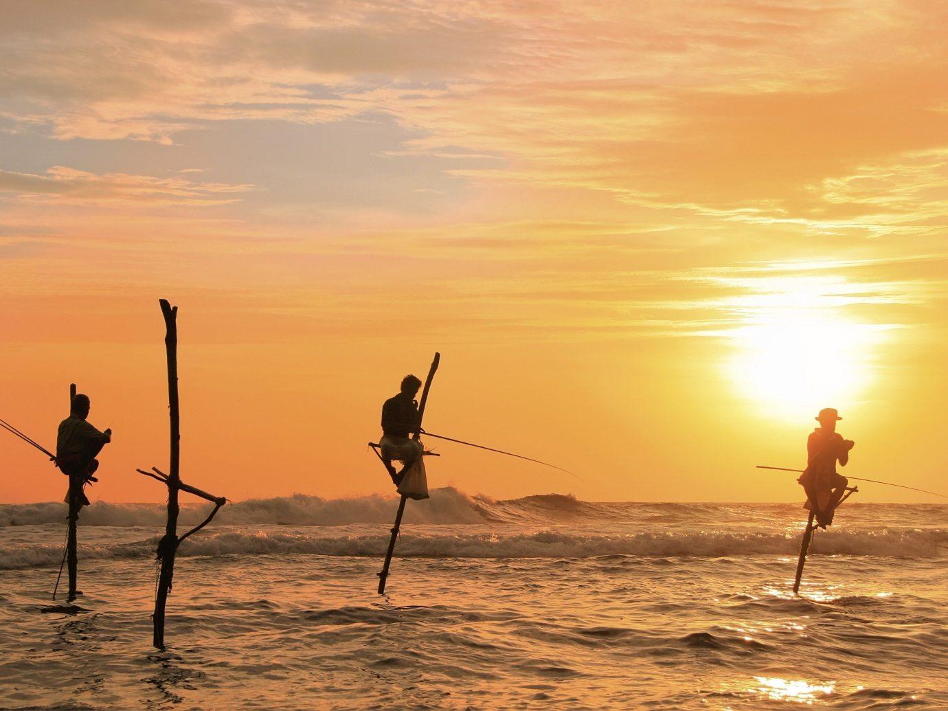 Travel Tips outdoor sky water Sea Sunset light horizon sunrise Sun Beach Ocean afterglow morning dawn Coast evening dusk wave