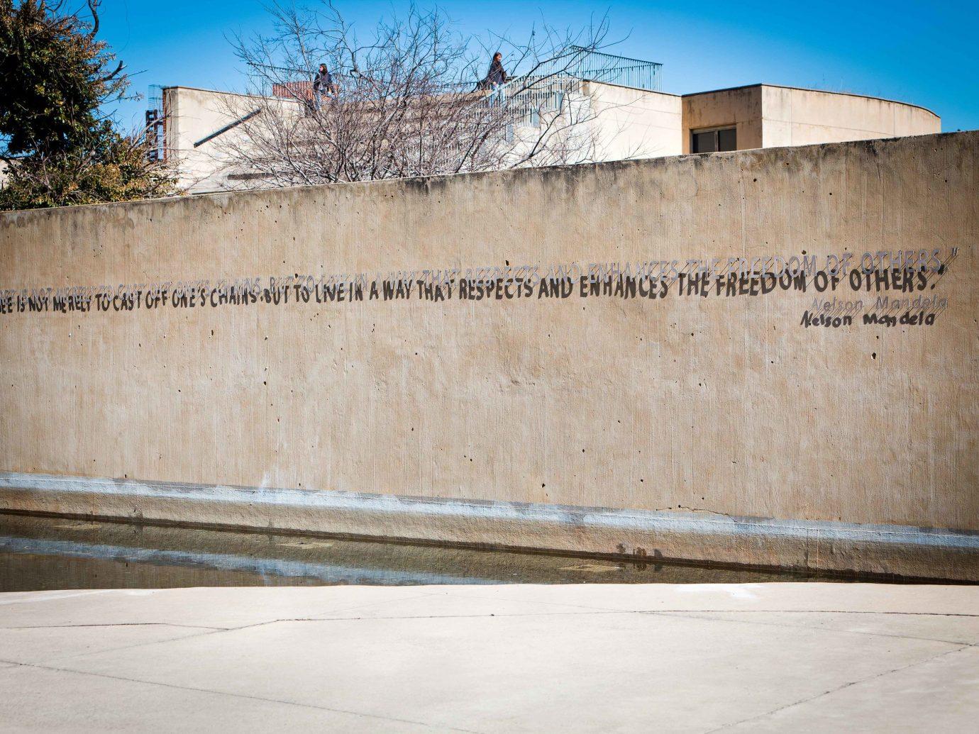 Arts + Culture Trip Ideas building outdoor wall Architecture facade sky concrete cement memorial step stone