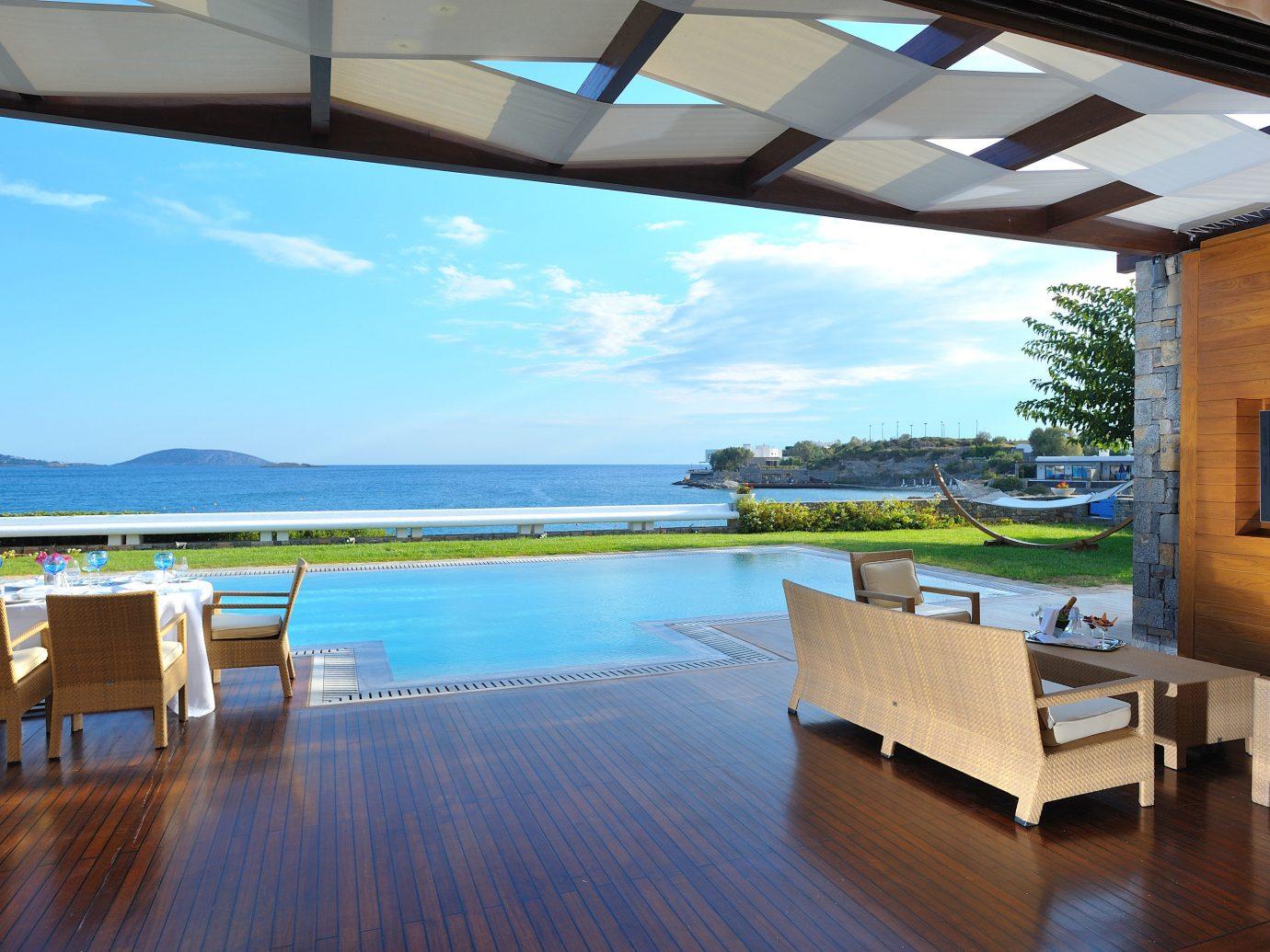 Hotels Luxury Travel floor table chair swimming pool property leisure wooden estate vacation Resort condominium Villa real estate home interior design apartment Deck furniture wood