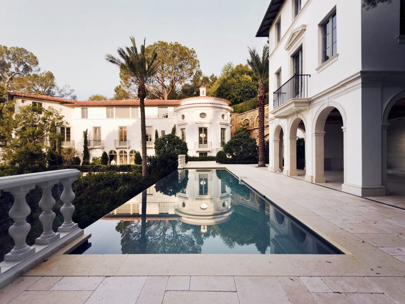 Offbeat outdoor property estate building Courtyard swimming pool Architecture mansion plaza reflecting pool home Villa palace park facade hacienda backyard stone walkway colonnade