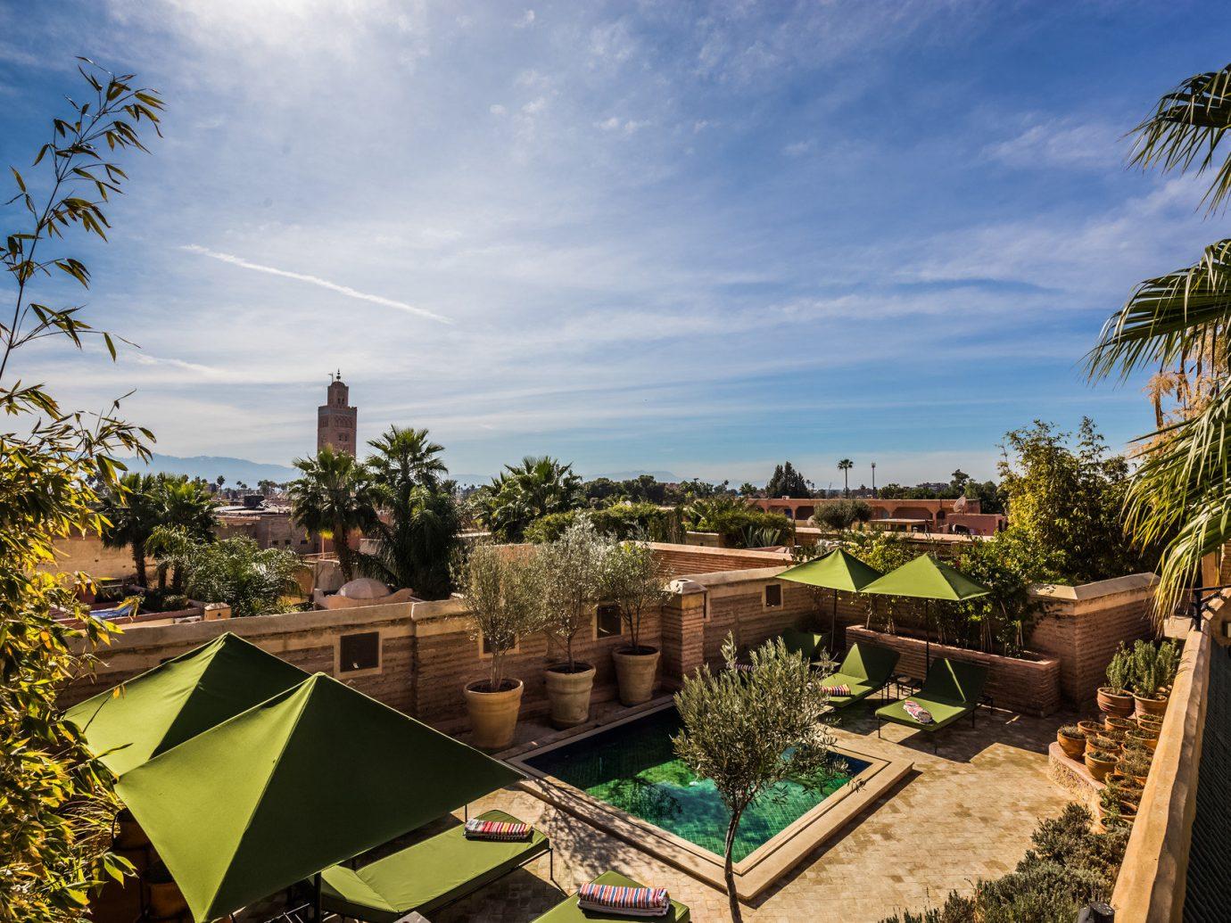 Hotels tree sky outdoor property Resort estate vacation arecales plant Garden Villa palm