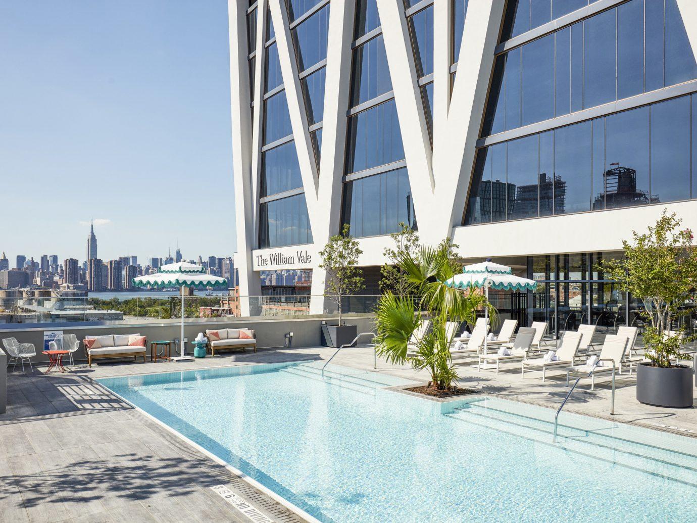 Hotels sky outdoor building leisure property swimming pool condominium plaza Architecture facade estate Resort headquarters apartment