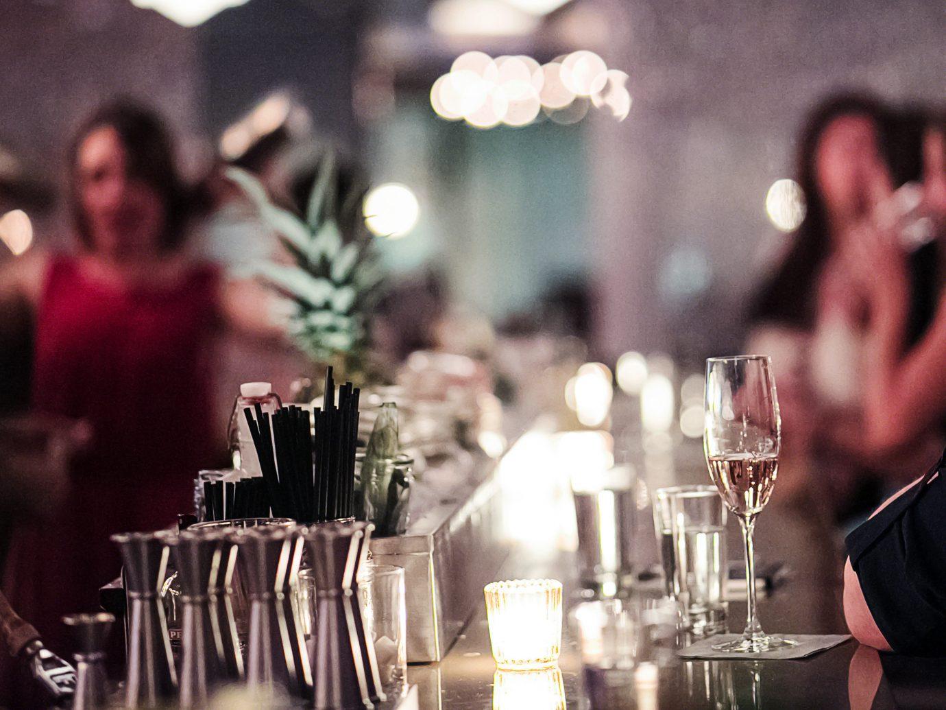 Food + Drink Hotels Romance Trip Ideas table indoor person Dining restaurant ceremony wedding rehearsal dinner wedding reception dinner Bar set