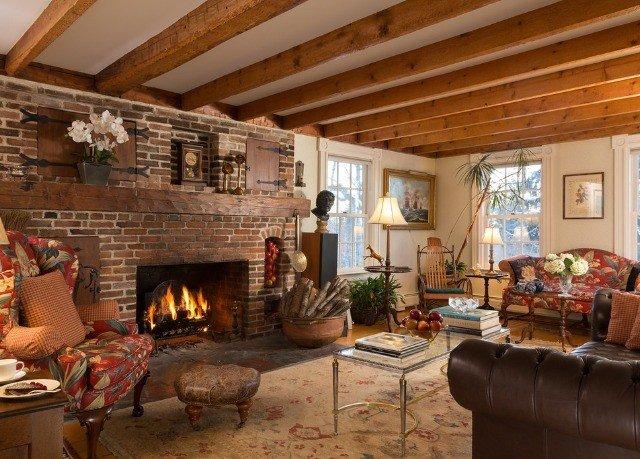 sofa Fireplace fire living room property home cottage log cabin farmhouse stone