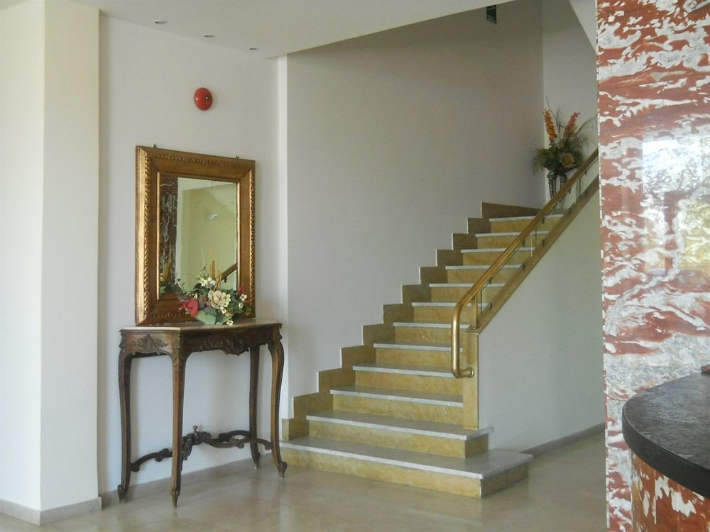 stairs property house home living room hardwood Fireplace cottage plaster flooring hall