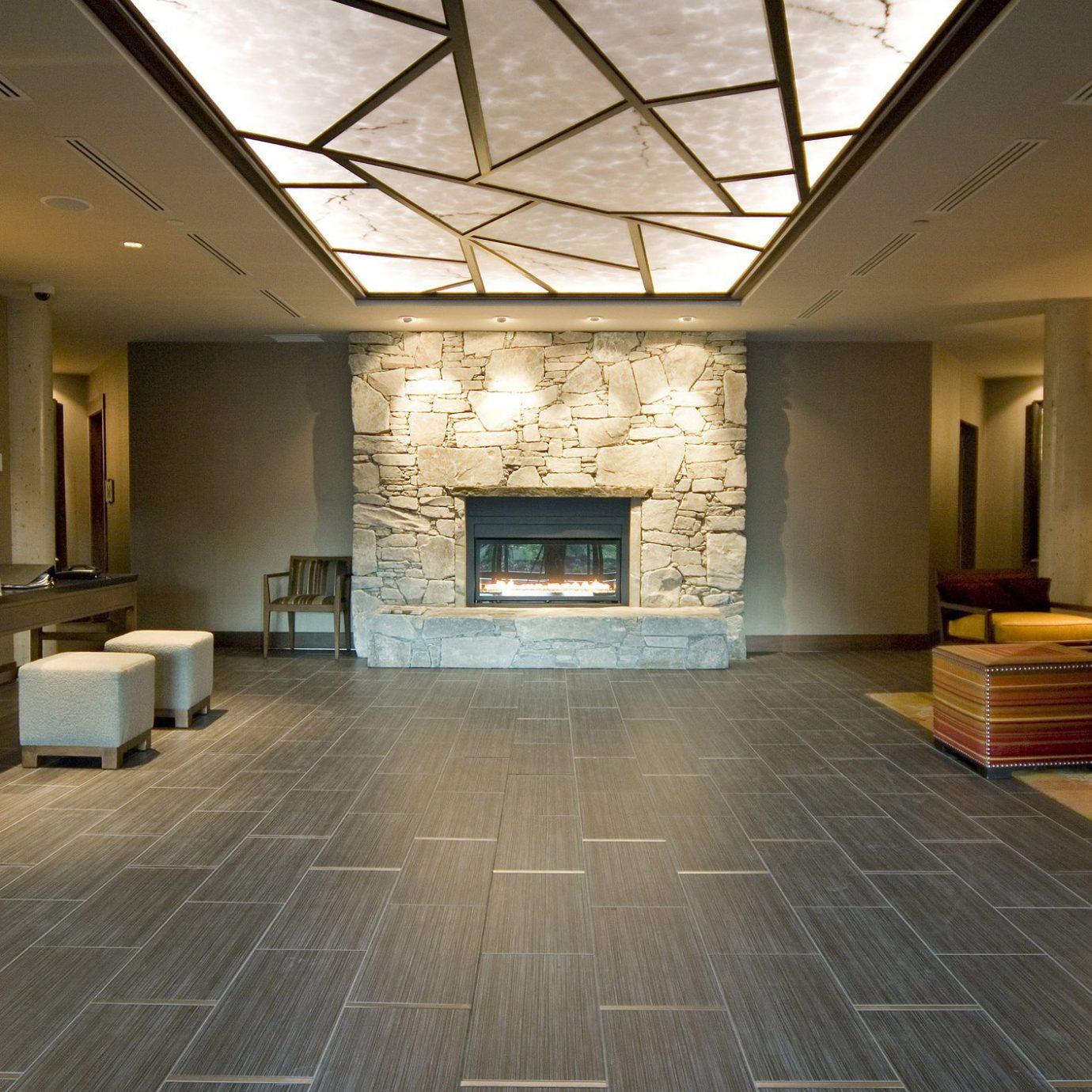 Fireplace Lobby Lodge Lounge Modern Mountains property building living room flooring hardwood wood flooring home lighting stone Island