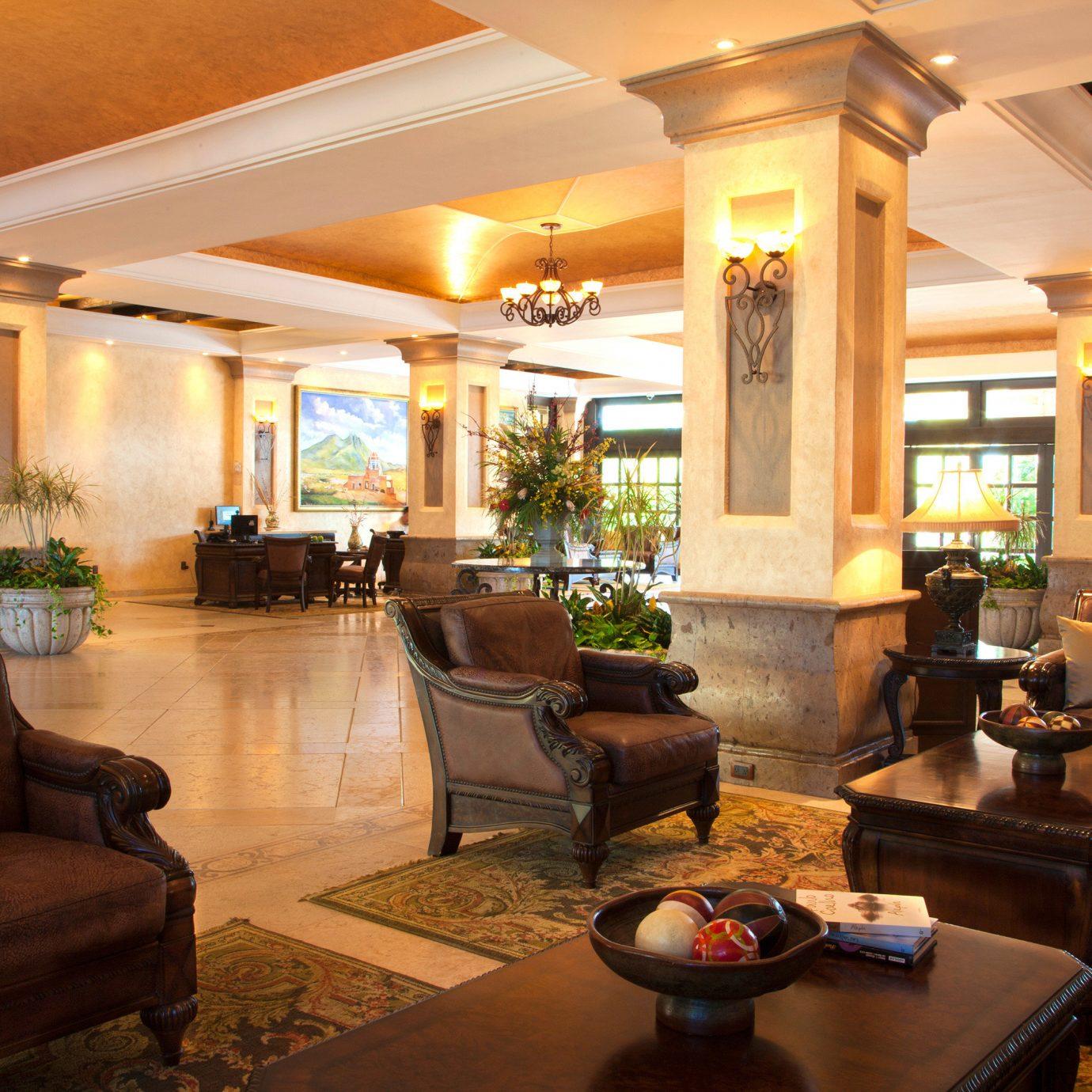 sofa Lobby property living room home Fireplace condominium Resort mansion Villa leather