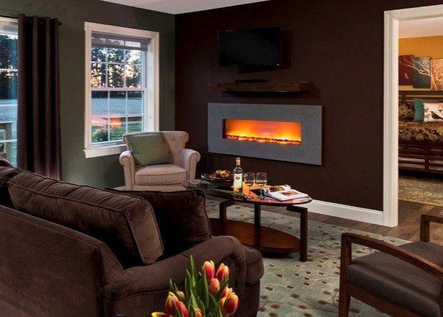 sofa living room property home Fireplace hearth cottage hardwood Suite leather