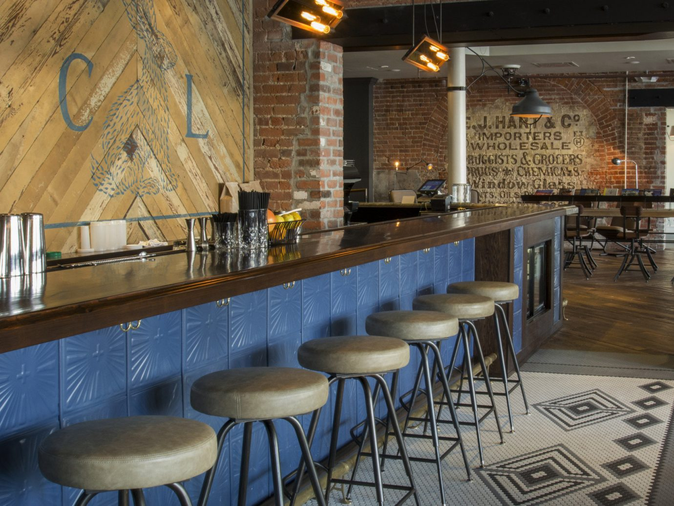 Bar bar seating Boutique Hotels brick wall Dining Hip Hotels industrial interior restaurant Rustic tables trendy Trip Ideas urban floor indoor chair room property dining room interior design estate meal cuisine area furniture