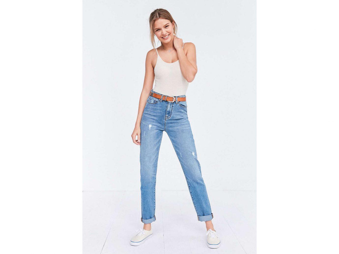 Style + Design clothing jeans denim person phone cellphone shoulder waist standing fashion model trousers joint abdomen one piece garment neck trunk trouser electric blue