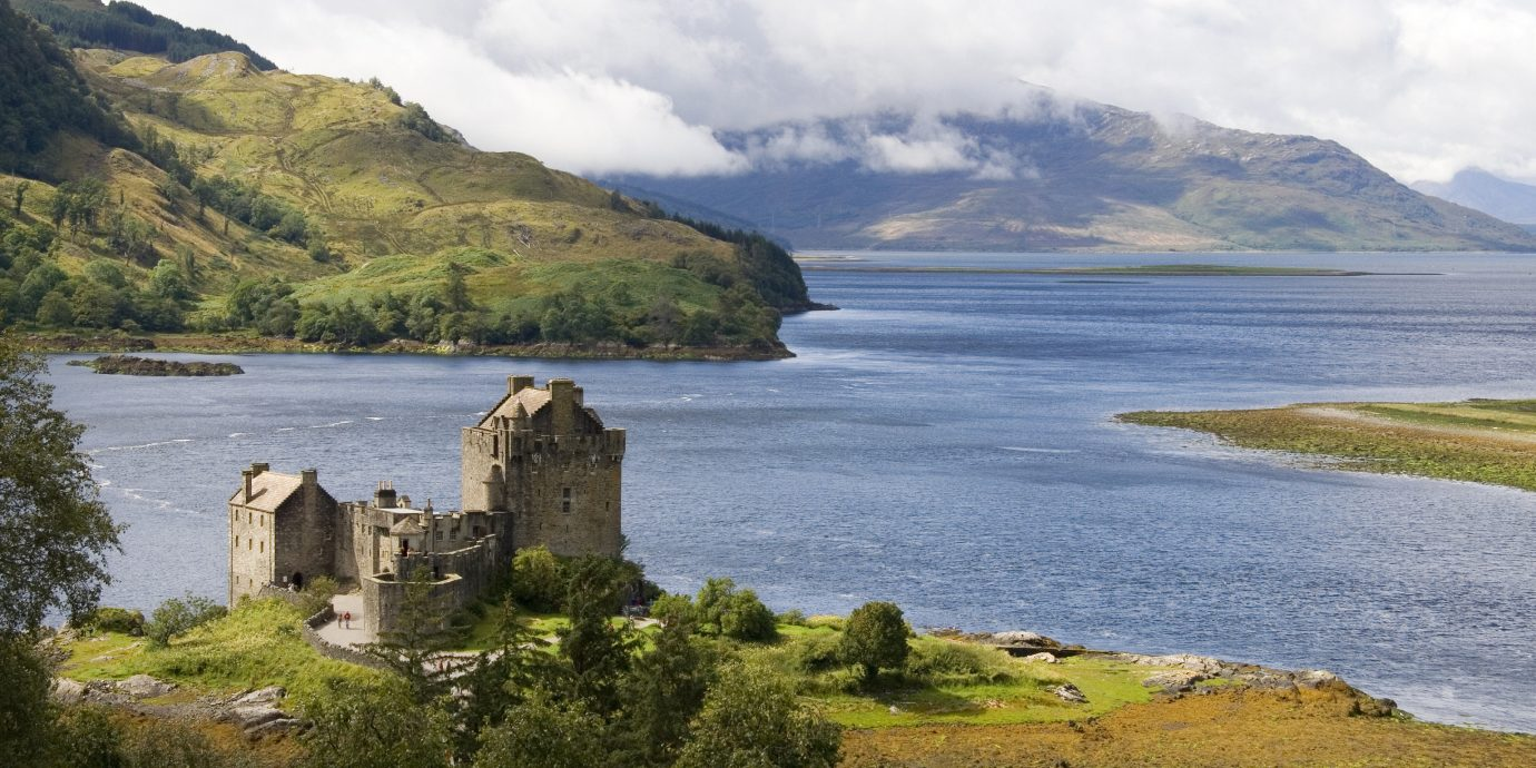 Landmarks Offbeat sky mountain water outdoor grass highland loch Lake Coast promontory Nature cloud lake district fell fjord Sea headland tree national trust for places of historic interest or natural beauty mount scenery bay hill landscape tarn inlet reservoir overlooking lush Island hillside