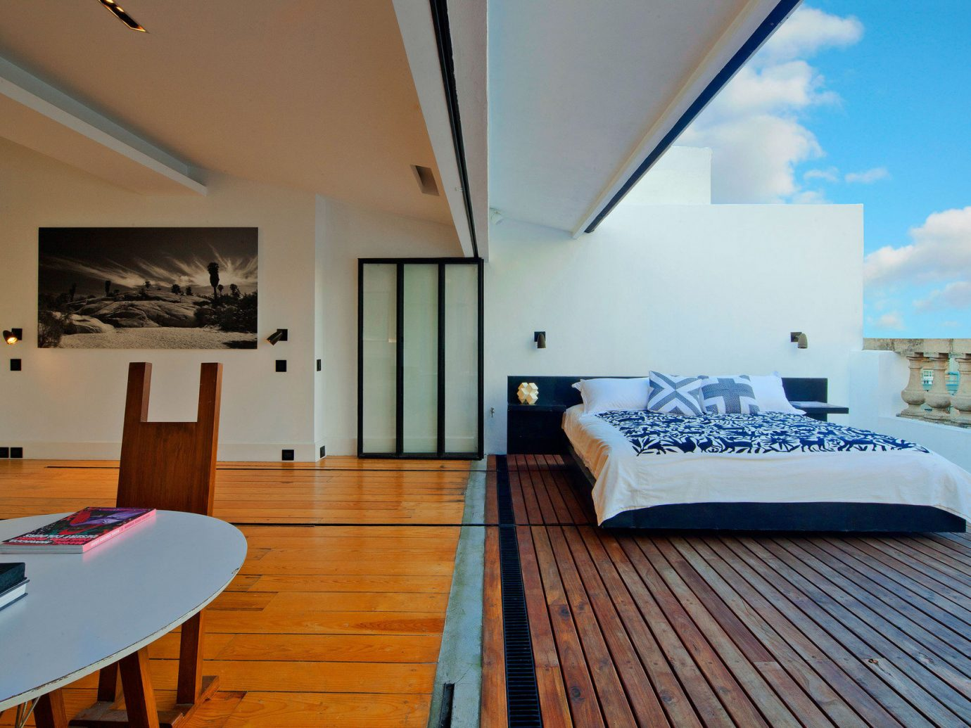 Balcony bed Bedroom Boutique Hotels Luxury Modern open-air Outdoors Patio regal sophisticated Terrace view indoor floor wall room property estate real estate Suite interior design Villa cottage Design living room apartment furniture condominium decorated