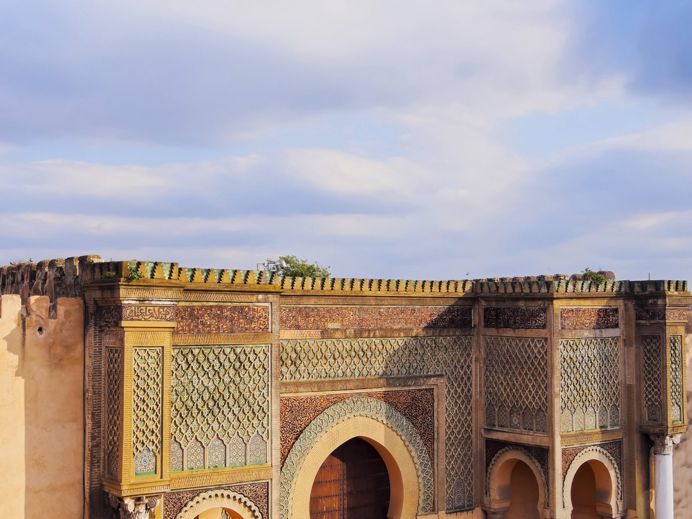 Arts + Culture Marrakech Morocco Style + Design historic site sky arch ancient history fortification wall history caravanserai building tourism palace facade