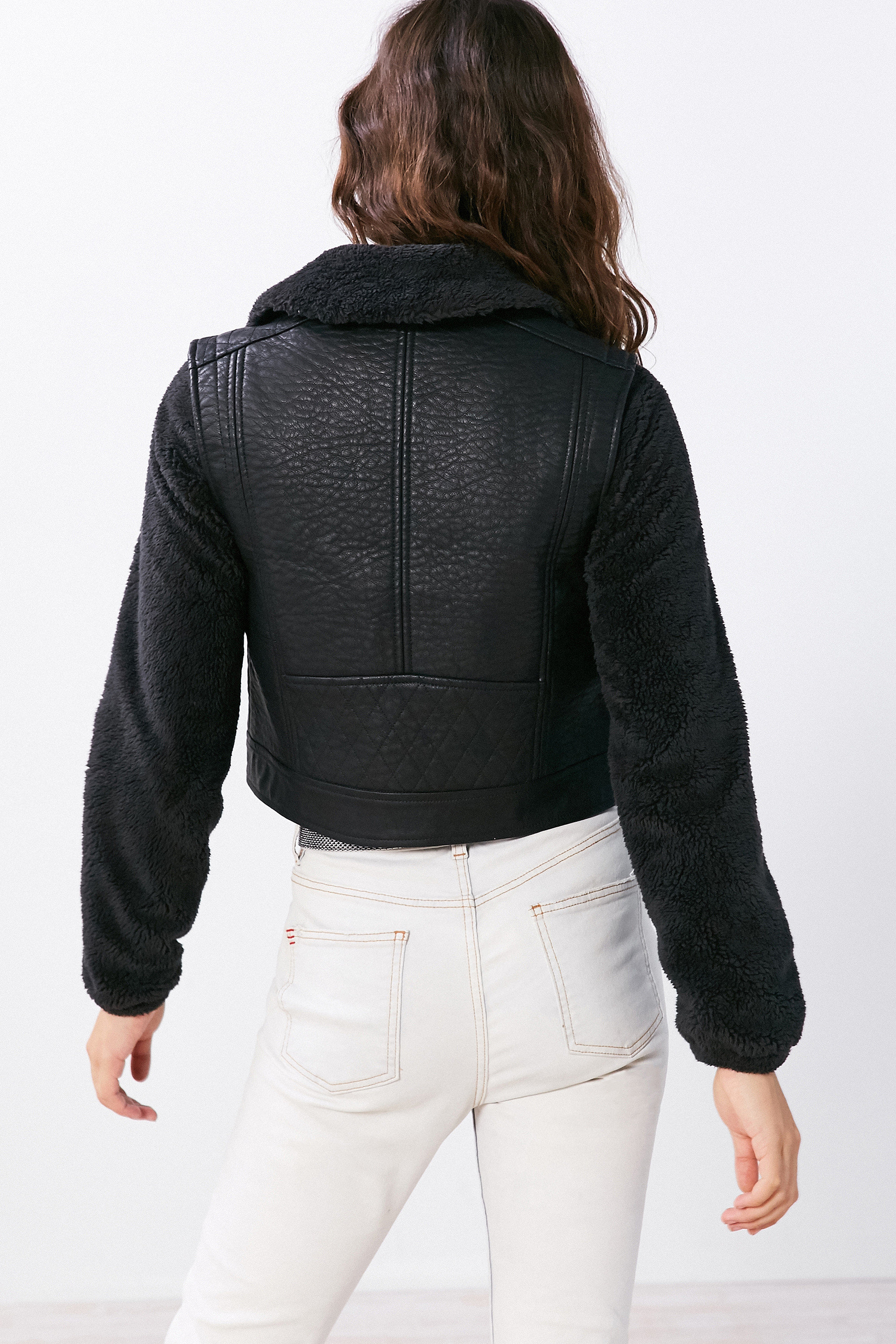 Style + Design person clothing hood jacket leather outerwear denim sleeve pocket textile zipper collar leather jacket material dressed arm