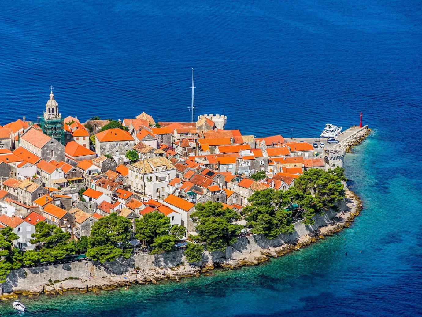 Secret Getaways Trip Ideas water Town Sea Coast orange vacation bay Harbor aerial photography cape Island cityscape Resort caribbean colored