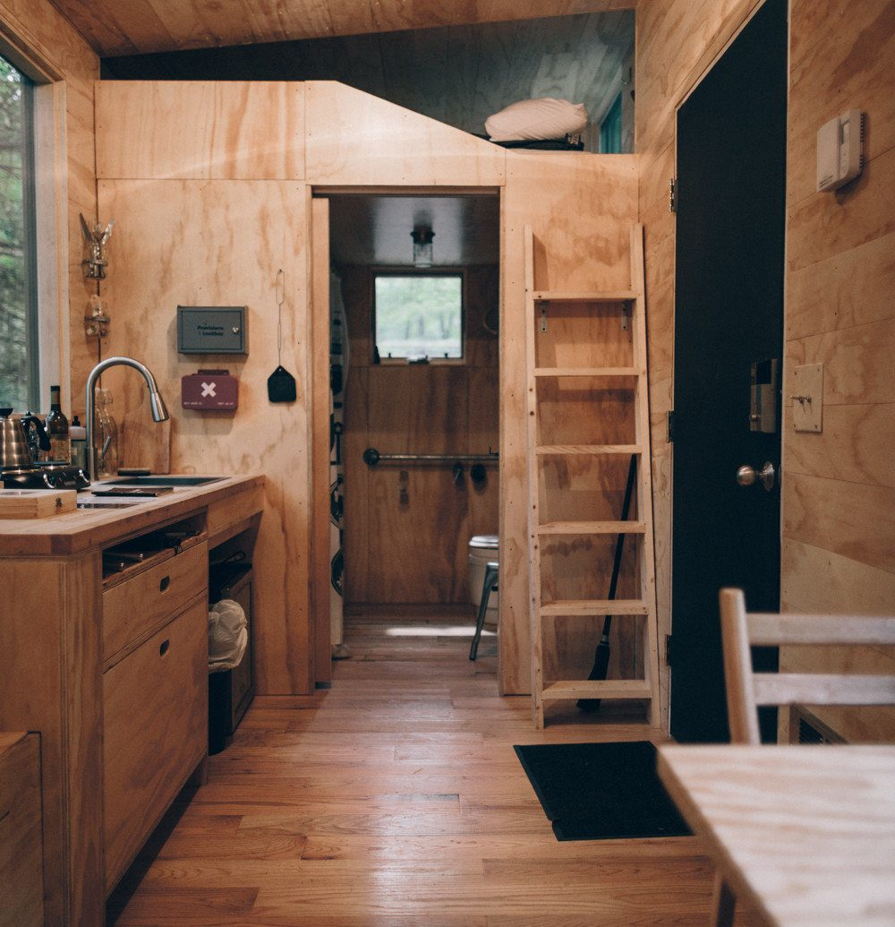 Boutique Hotels Fall Travel Hotels Outdoors + Adventure indoor floor building wood wooden ceiling room Architecture interior design home log cabin hardwood wood flooring house cabinetry flooring beam Kitchen wood stain open furniture stone