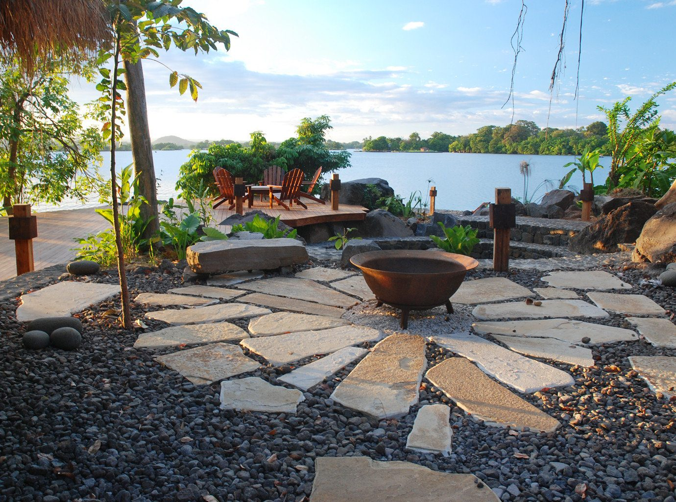 All-inclusive Eco Grounds Resort Romance Romantic Trip Ideas Wellness sky ground outdoor property walkway backyard yard estate swimming pool home real estate Patio landscaping Garden plant sandy stone several