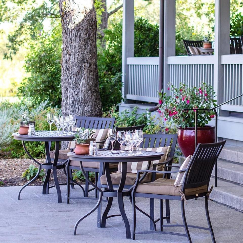 Food + Drink tree outdoor property room porch home backyard outdoor structure furniture Patio table yard real estate cottage estate Courtyard