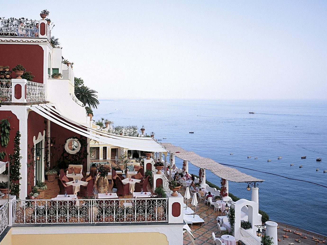 Hotels Romance sky outdoor Boat vacation Sea Town tower Coast tourism Beach people vehicle Resort Deck