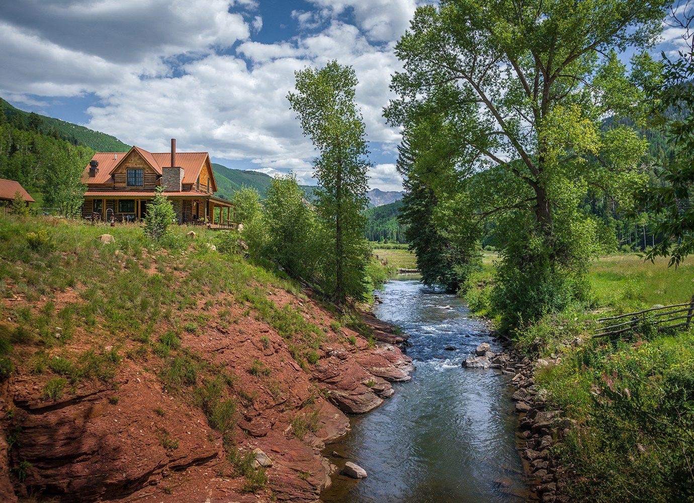Glamping Outdoors + Adventure Trip Ideas tree outdoor Nature landform River wilderness water body of water rural area waterway stream valley landscape narrow path autumn mountain flower trail hillside surrounded lush