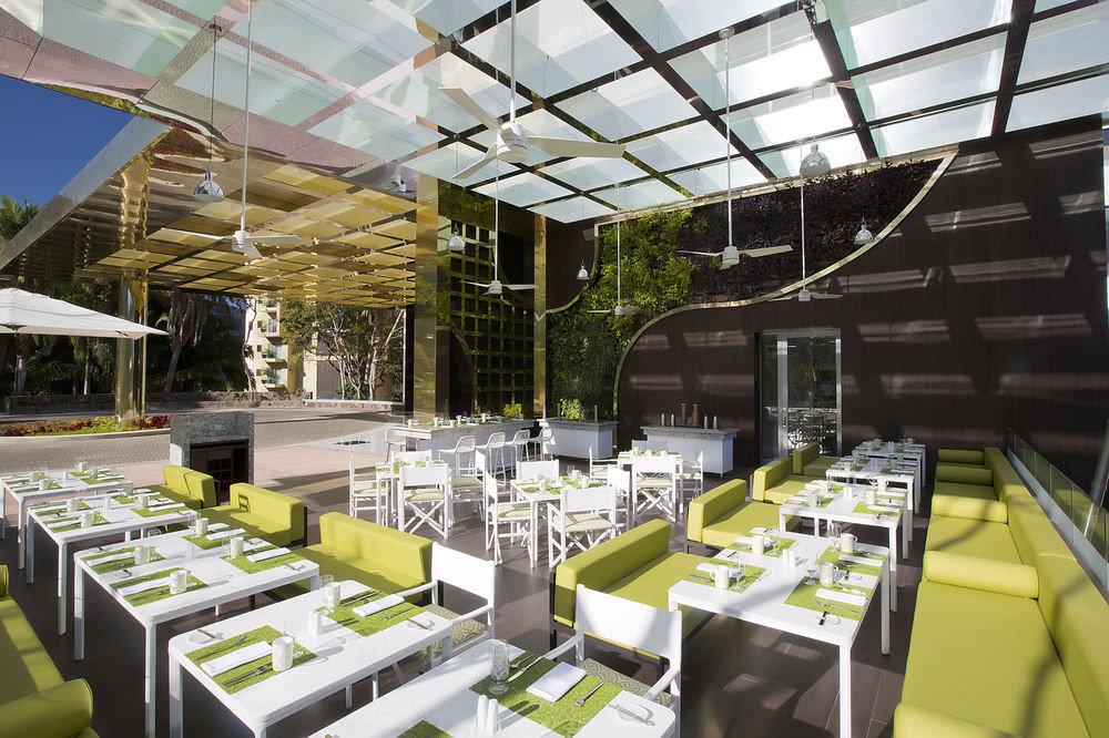 All-Inclusive Resorts Hotels table indoor meal convention center interior design restaurant Design set several