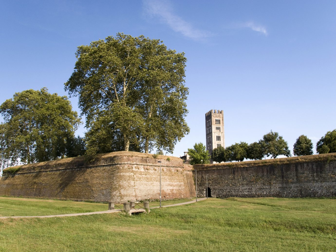 Italy Trip Ideas grass sky outdoor tree wall archaeological site field fortification historic site Ruins ancient history estate landscape grassy pasture lush