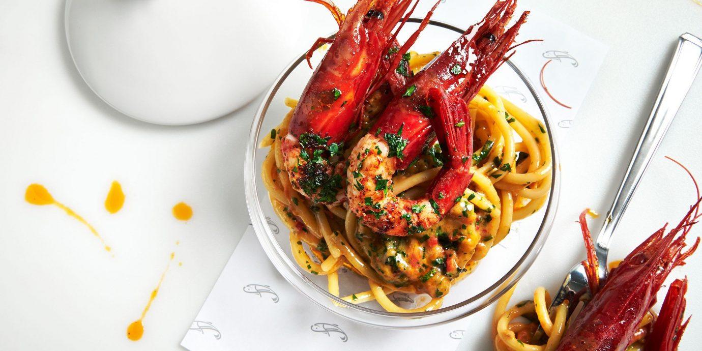 Food + Drink plate food dish indoor produce vegetable cuisine spaghetti meal Seafood italian food european food meat lobster piece de resistance