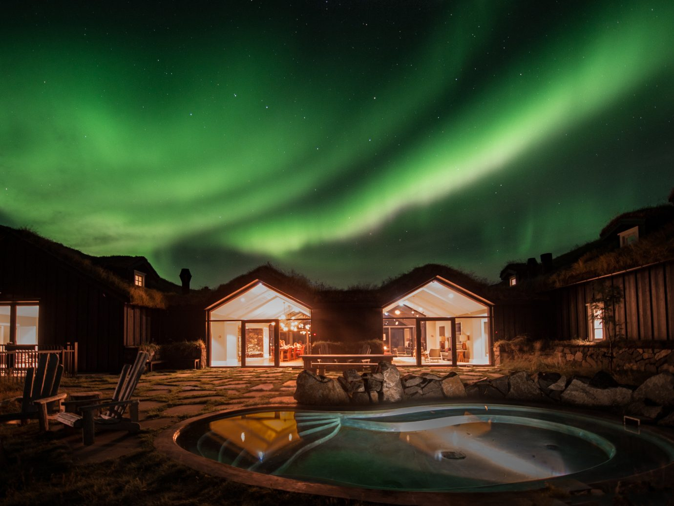 Boutique Hotels Hotels Outdoors + Adventure Winter aurora sky atmosphere night phenomenon lighting home house darkness evening midnight landscape cloud several Night Sky