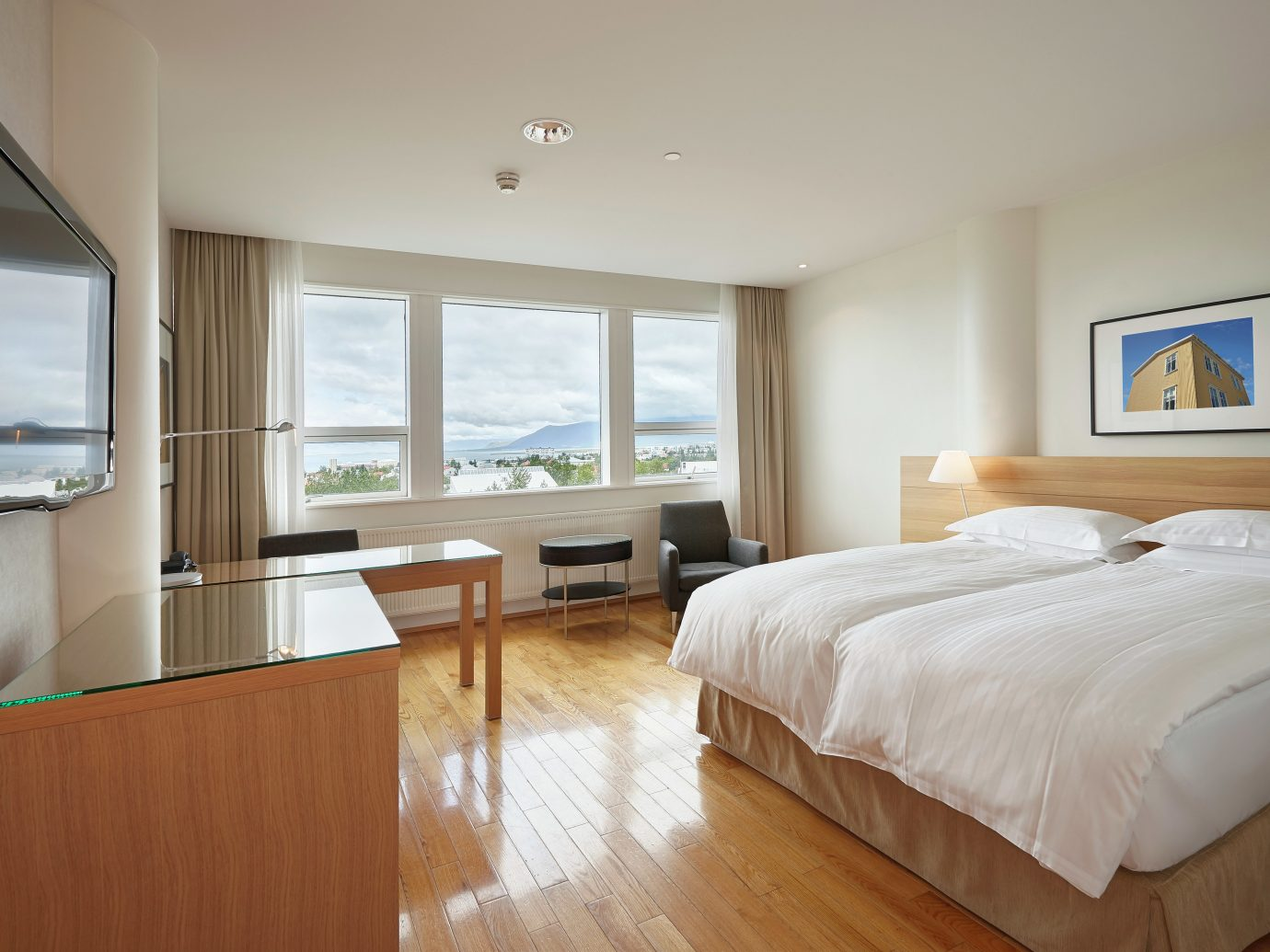Bedroom Classic Hotels Iceland Modern Scenic views Waterfront bed indoor wall floor window ceiling room property hotel real estate estate scene home hardwood cottage interior design Suite apartment wood