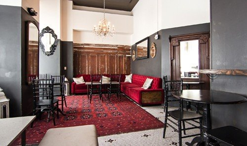 Food + Drink indoor floor room wall Living property chair Suite dining room real estate cottage estate interior design condominium living room Villa apartment furniture Bedroom area decorated leather