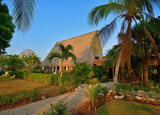 tree grass sky palm plant property Resort arecales path Village plantation Jungle Garden lined lush