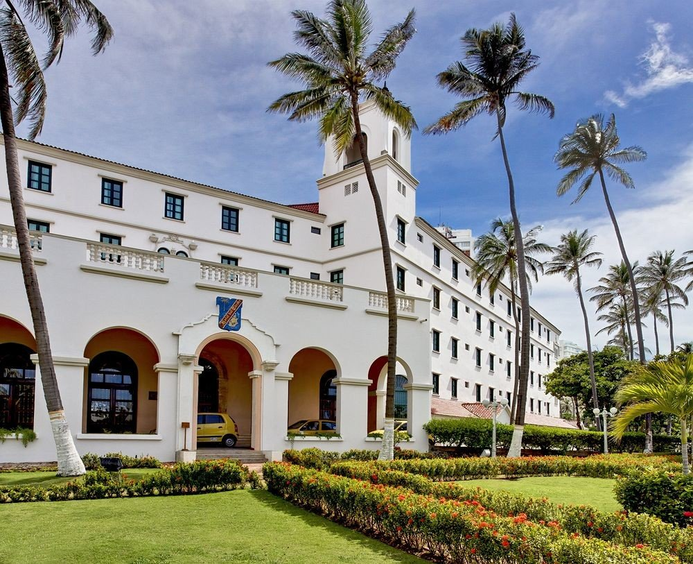 grass building tree sky property house home arecales palace hacienda mansion Villa Resort Garden plant palm stone