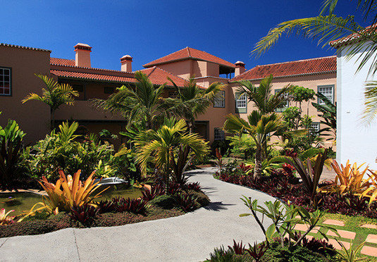 tree sky plant palm property Resort home arecales Villa swimming pool backyard caribbean tropics palm family condominium Garden bushes